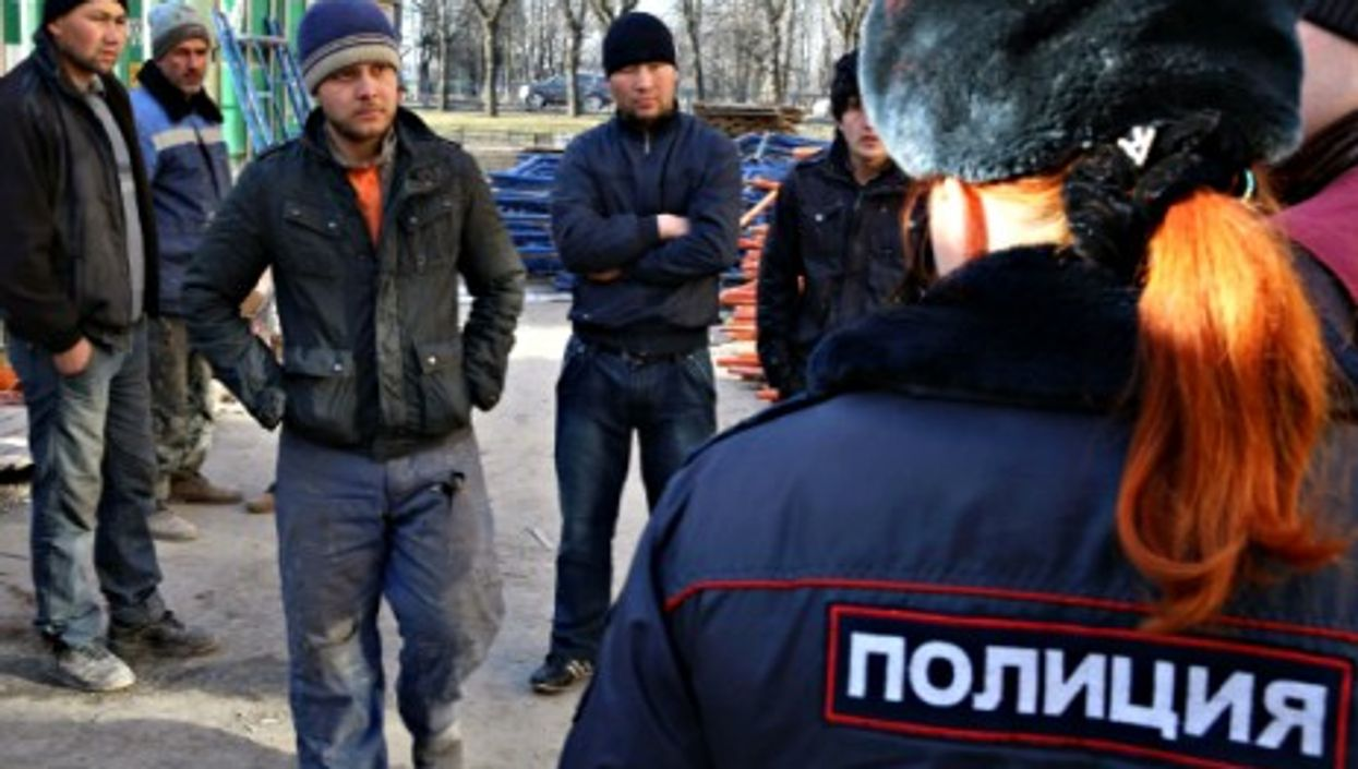 Immigration officer conducting a search in St. Petersburg, Russia