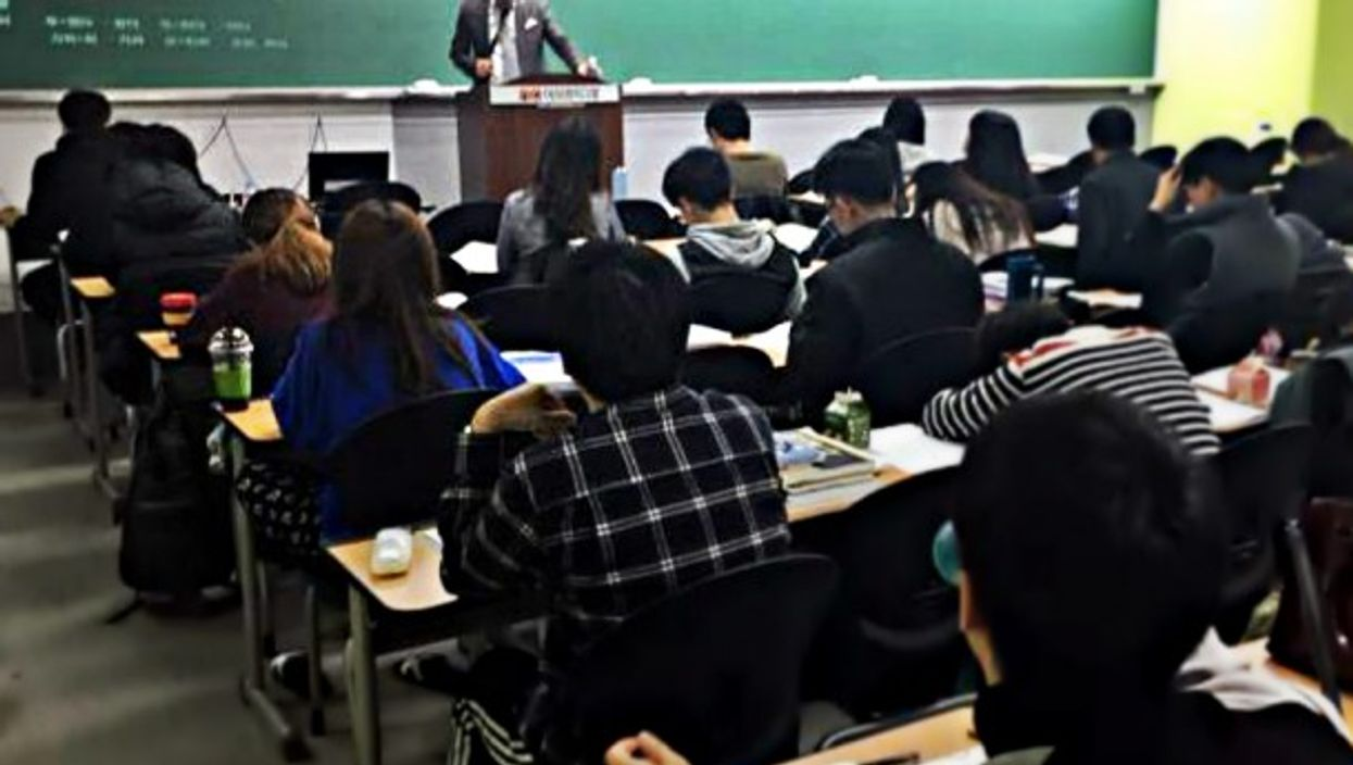 In a classroom in Seoul, students study for an exam