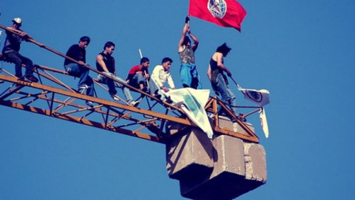 In a file photo, a Socialist flag flies in Beirut.