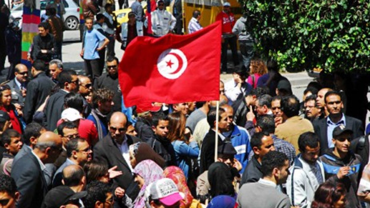 In a file photo, Tunisians rally for freedom of expression.