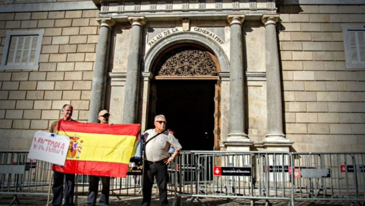 In Barcelona, opponents of Catalan independence hold Spanish flag