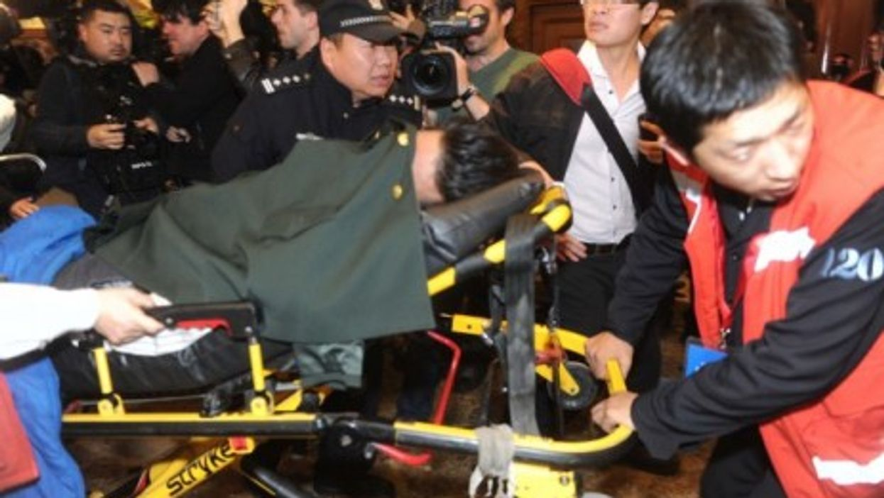 In Beijing, a mourner faints at news of Malaysian Airlines plane's demise