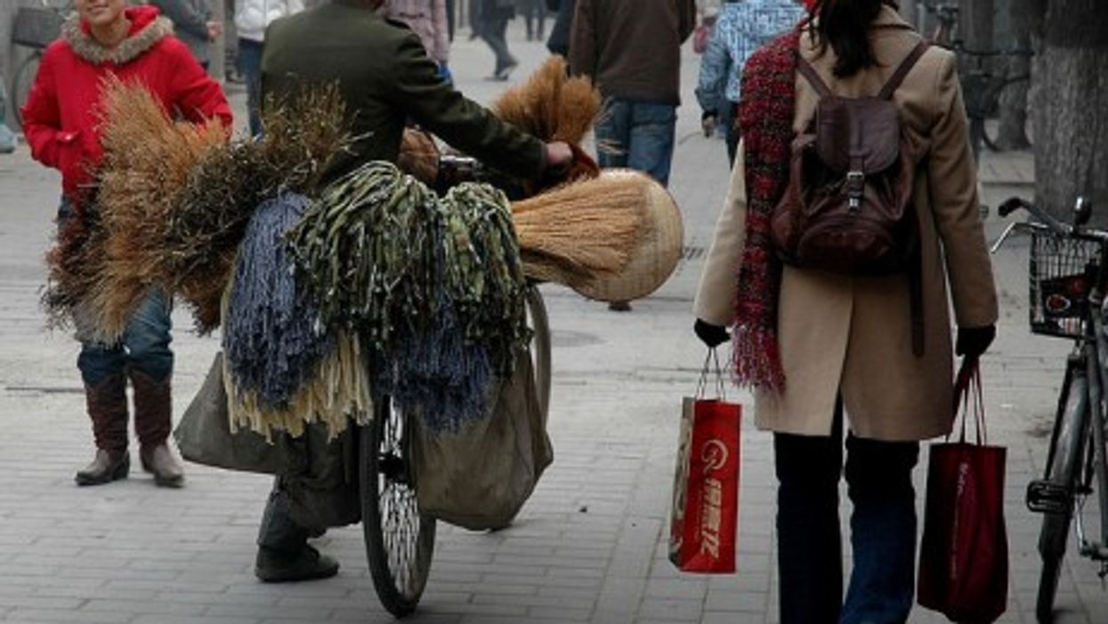 In Beijing, people moving in different directions -- the rich increasingly, abroad. (sherrattsam)