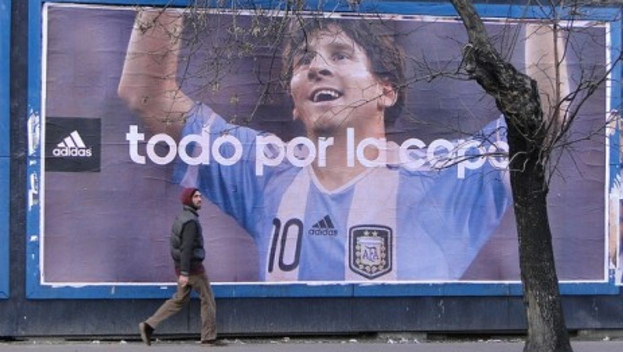 In Buenos Aires, Argentina (above) Lionel Messi enjoys larger than life hero status