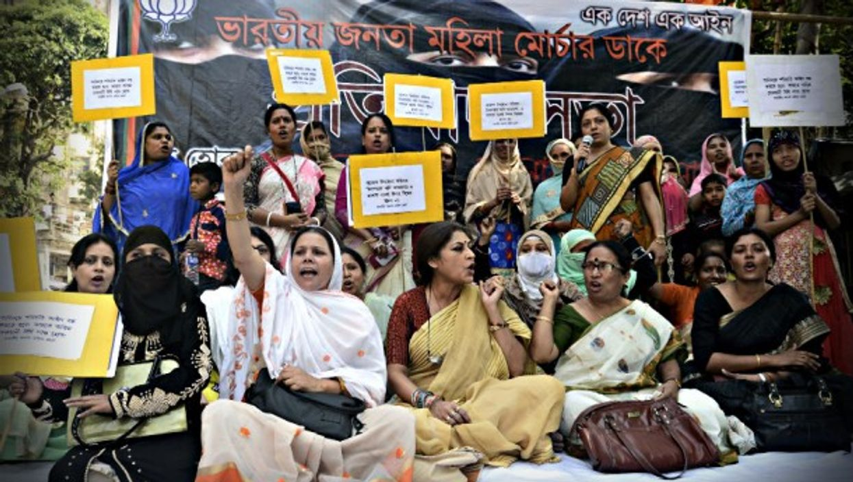 In India, Muslim women hold poster to protest Triple talaq divorce practice