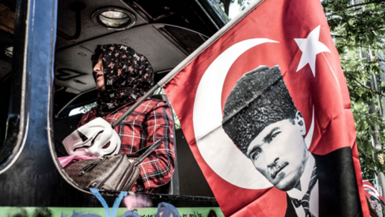 In Istanbul with an Ataturk flag and Anonymous mask.