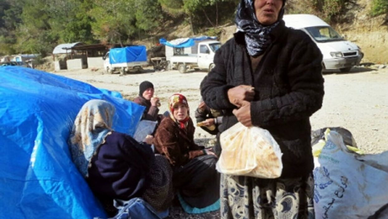 In Oncupinar, Syria, trying to enter Turkey.
