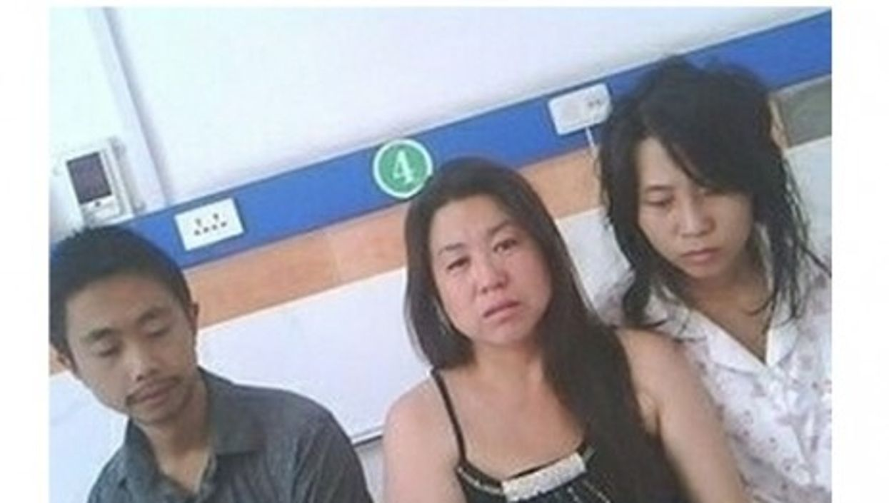 In one of the widely circulated photos, Feng Jianmei (rt) with her brother and sister-in-law after the forced abortion