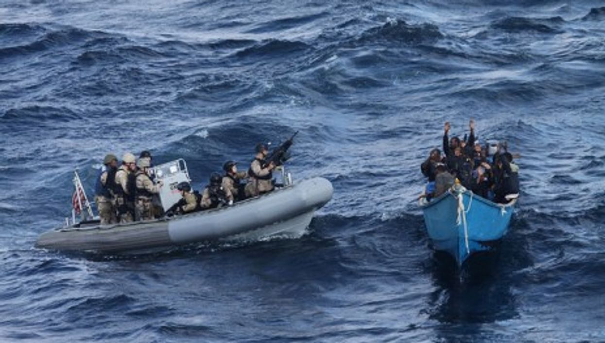 In the Indian Ocean, American Navy troops take suspected pirates into custody (US Navy)