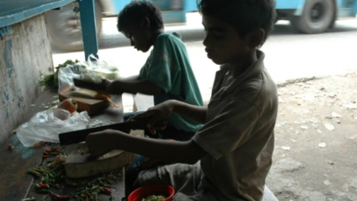India children working on the side of a road in West Bengal