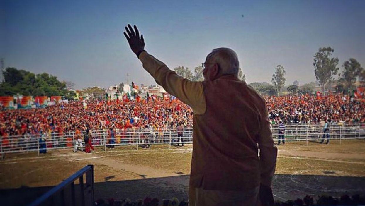 Indian PM Modi waving in Bijnor