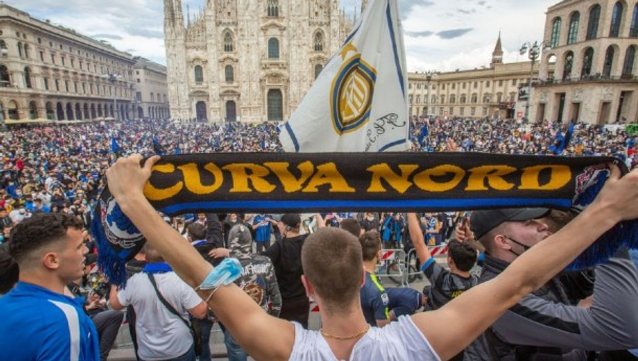 Inter Milan supporters are celebrating outside the Duomo di Milano after the Italian soccer team won the Serie A title for the first time in 11 years, ending Juventus' nine-year reign in Italy.