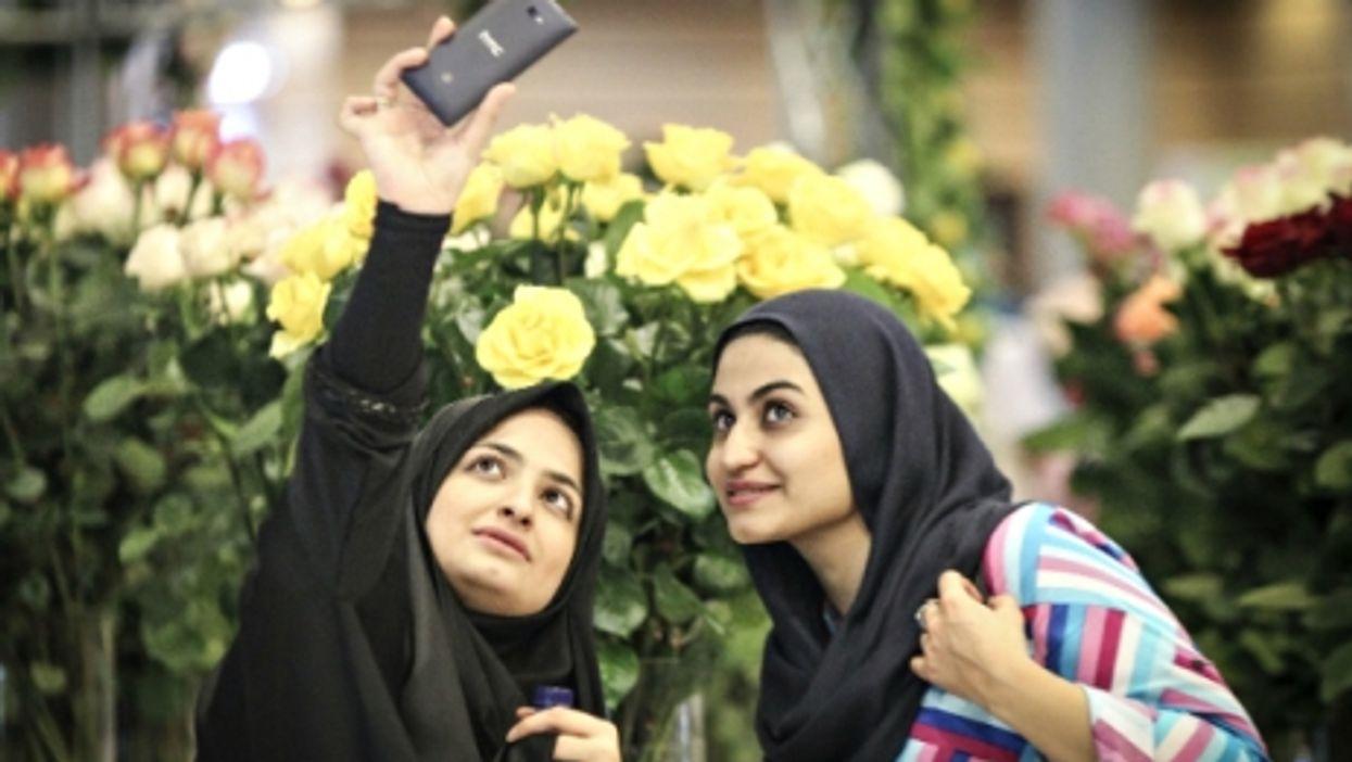 Iranian women taking a selfie at Tehran's International Flower Exhibition on May 13