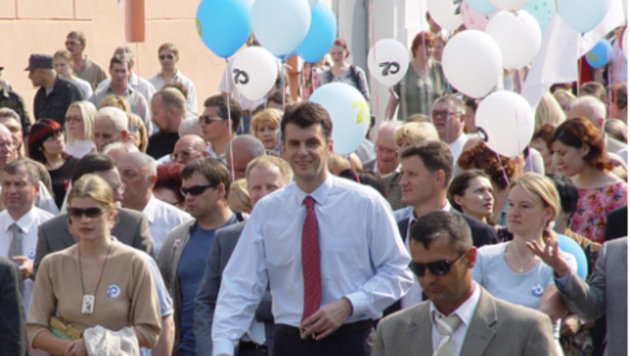 Is Prokhorov (center) a man of the people?