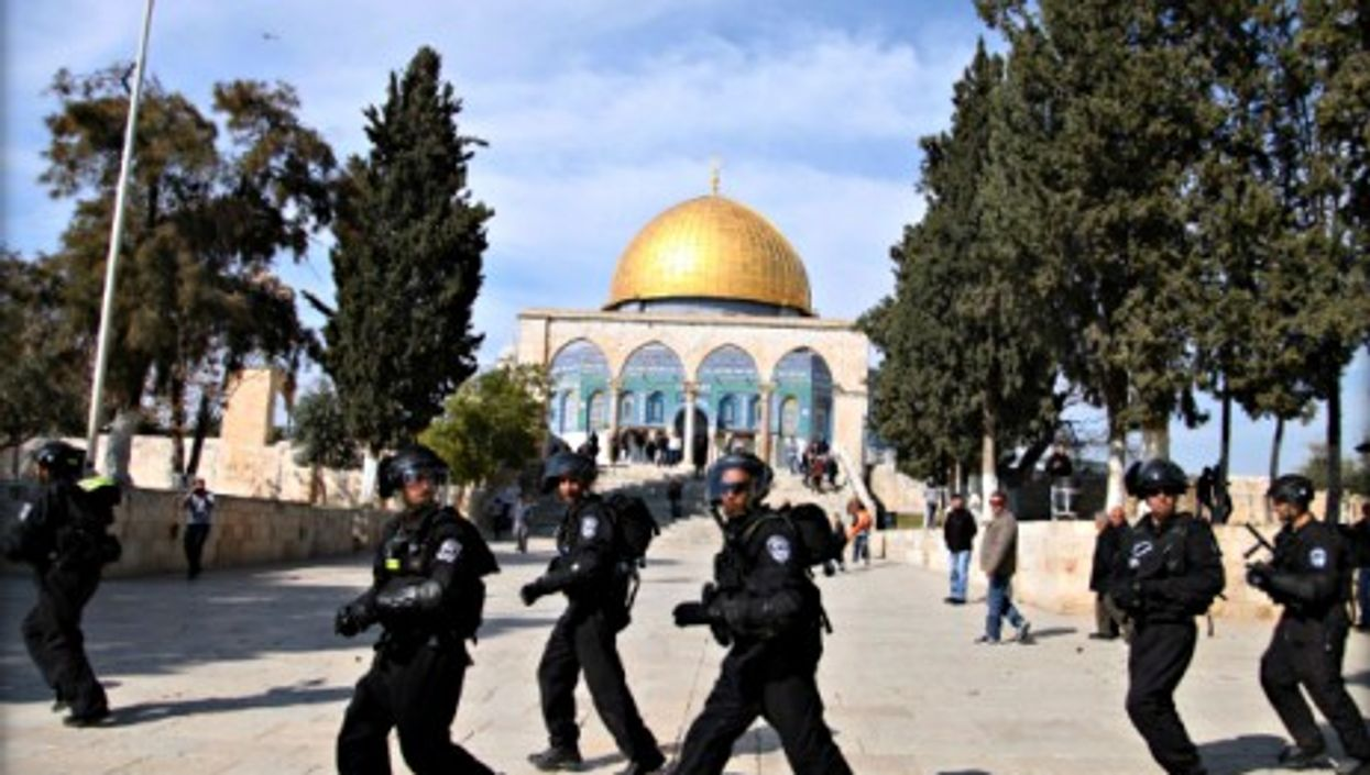 Israeli policemen in front of Jerusalem's Dome of the Rock during clashes with Palestinians on Feb. 7