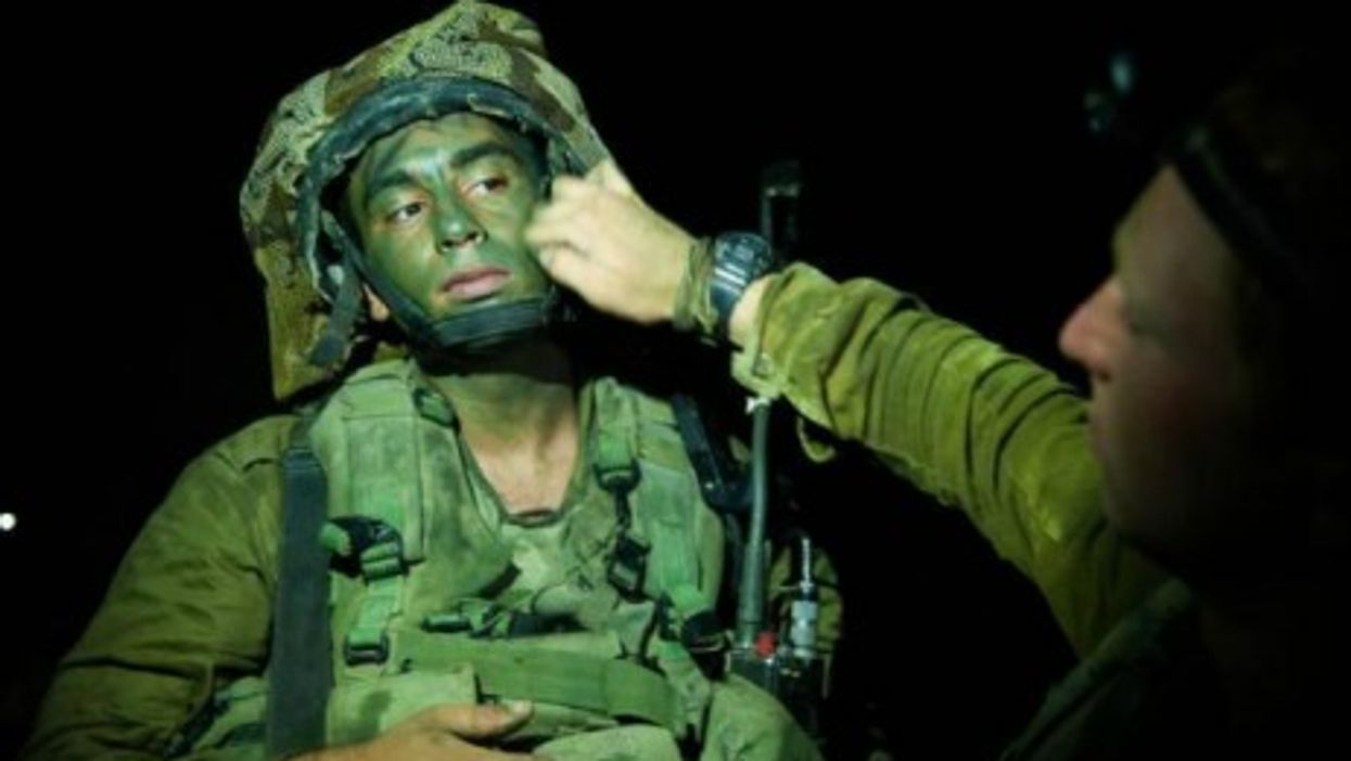Israeli soldier preapring to enter Gaza on July 17.