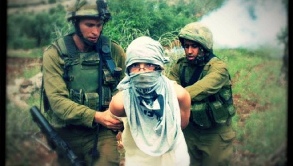 Israeli soldiers arrest an Israeli settler