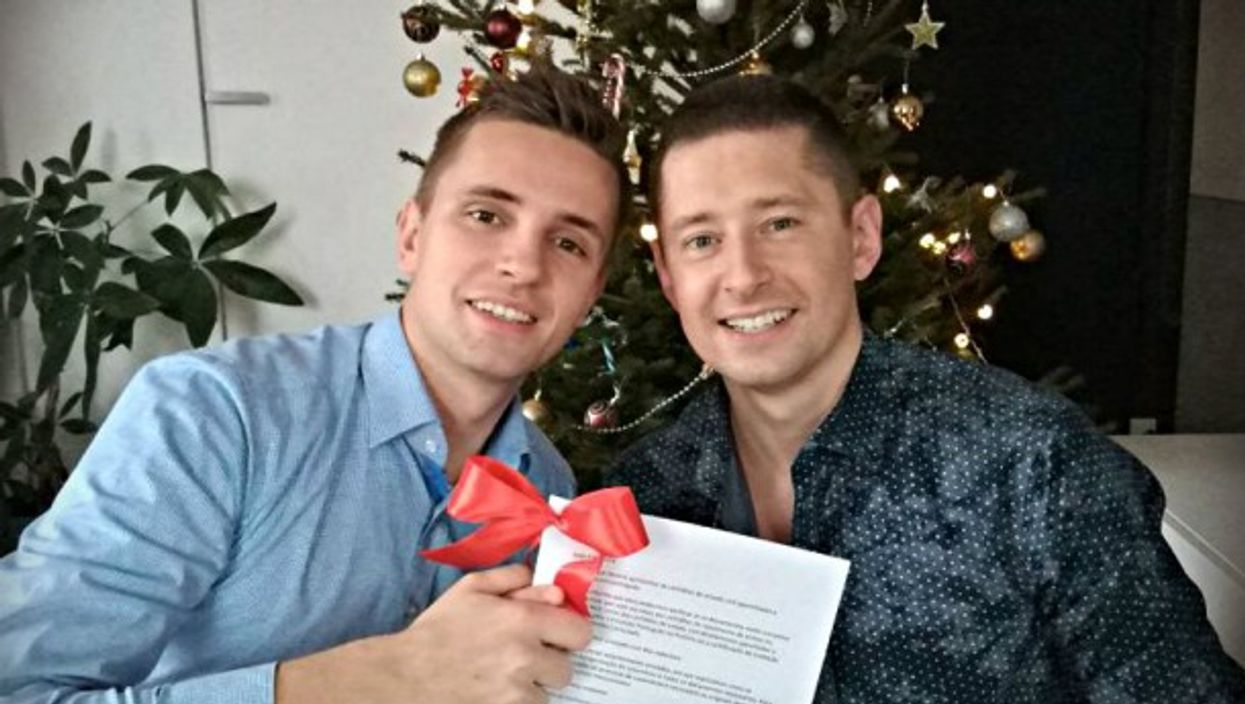 Jakub and Dawid with their marriage certificate