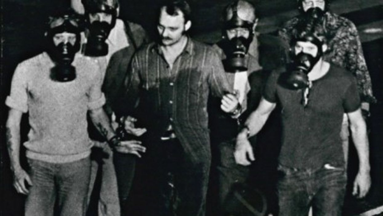 Jan Erik Olsson escorted from the bank after his surrender on Aug. 28 1973