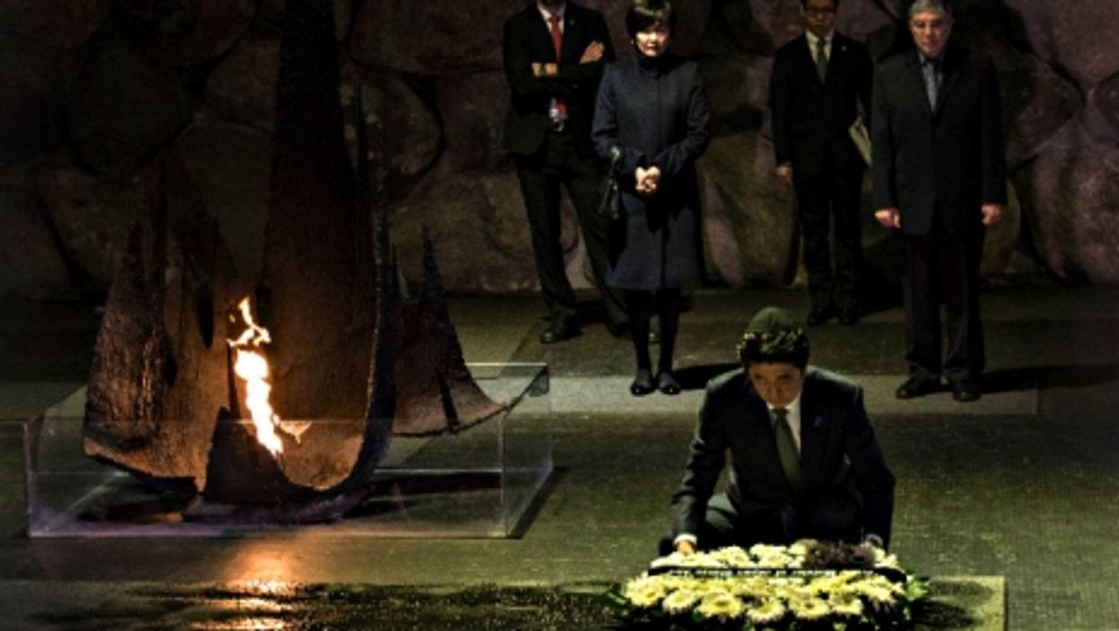 Japan's PM Shinzo Abe at Jerusalem's Yad Vahsem Holocaust memorial museum in January.