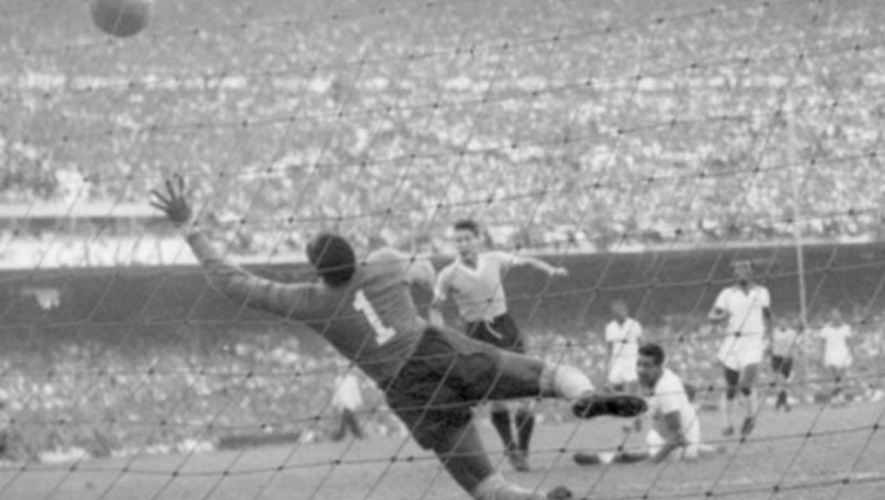 Juan Alberto Schiaffino of Uruguay score in the 66th minute of the infamous 'Maracanazo'match