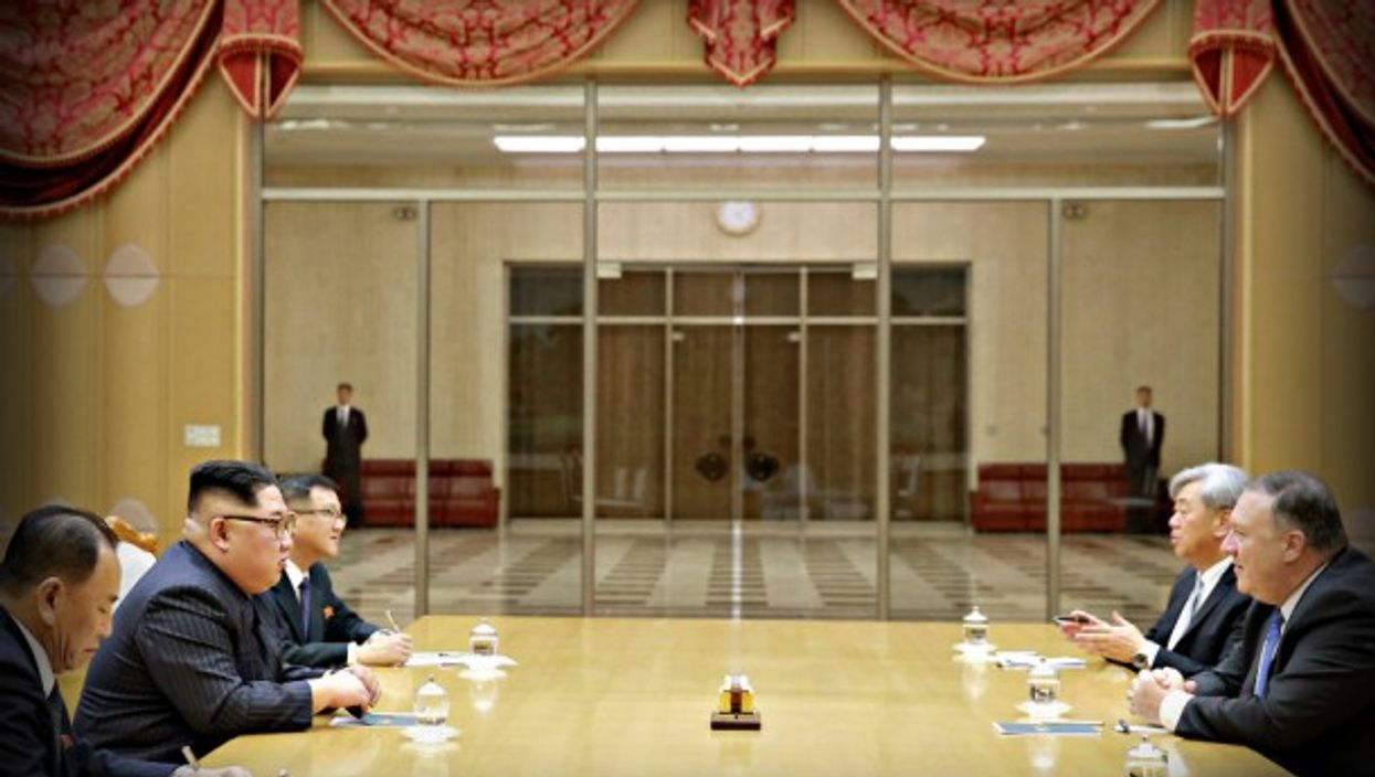 Kim across the table from U.S. Secretary of State Mike Pompeo in Pyongyang.