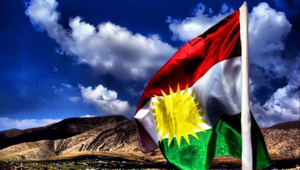 Kurdish flag flies bright