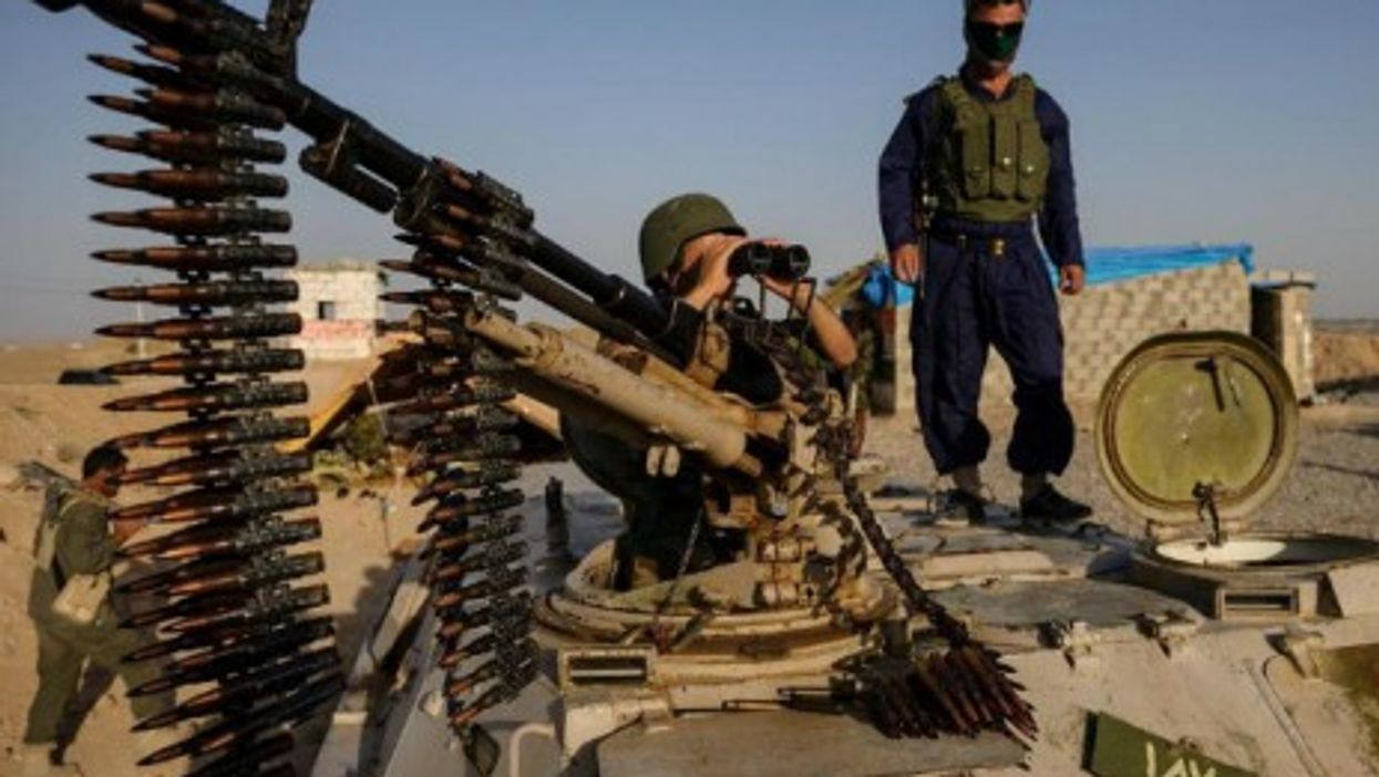 Kurdish forces are trying to reclaim the eastern Iraq city of Jalawla, after it fell to al-Qaeda-inspired insurgents.