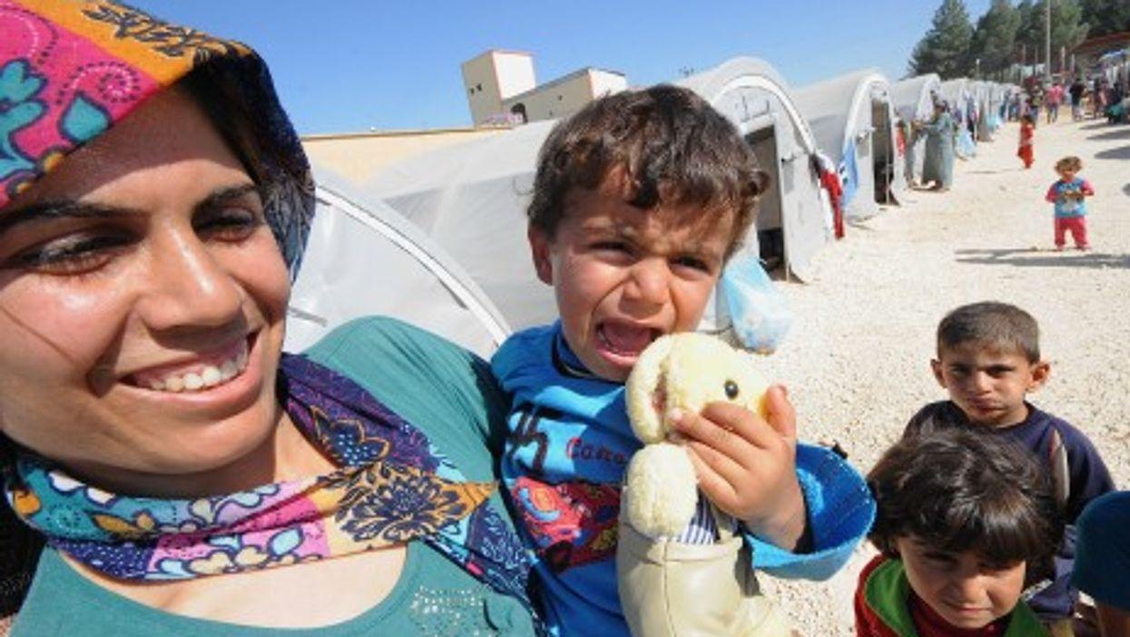 Kurds flee Kobani, Syria for safety in Turkey.