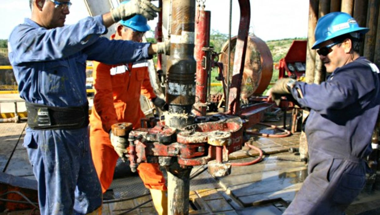 Laborers work to extract oil in Colombia
