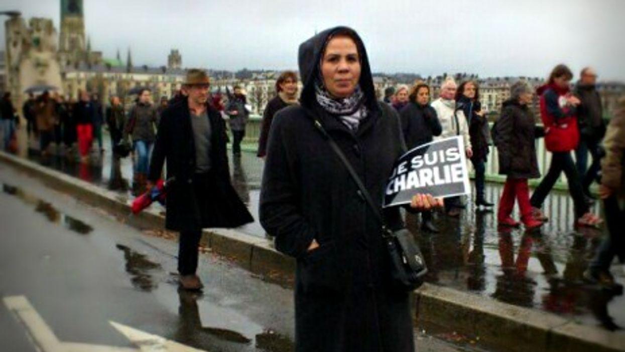 """Latifa Ibn Ziaten shows her """"Je suis Charlie"""" support."""