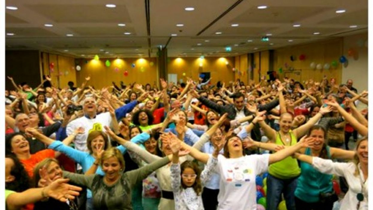 Laughing together at the opening ceremony of European Laughter Yoga Conference in Lisbon