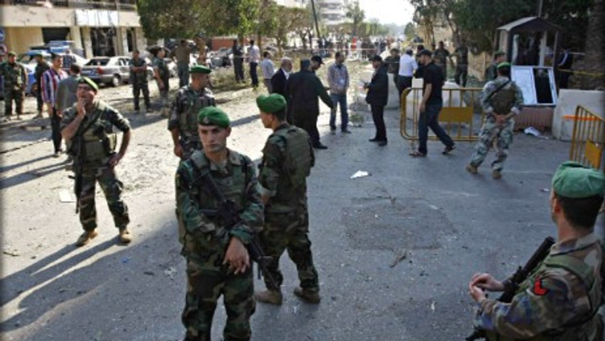 Lebanese soldiers guarding the site of the Nov. 19 blast in Beirut