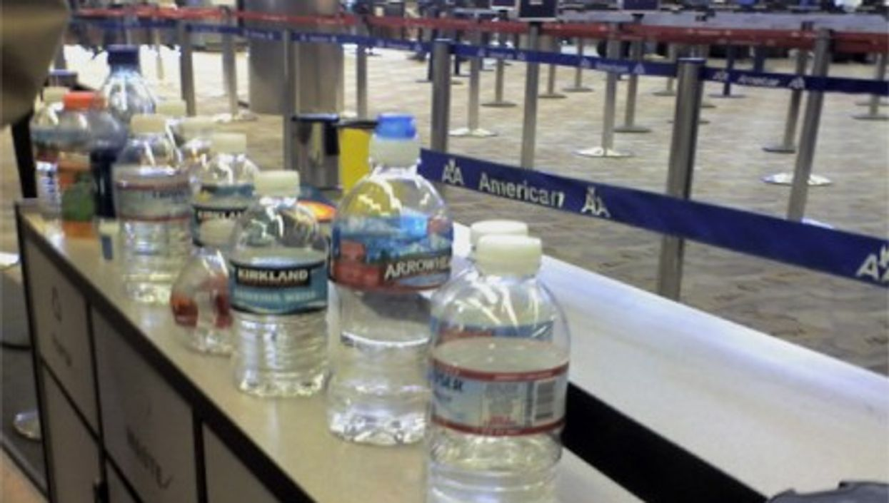 Left-behind water bottles have become common airport scenery (chelzerman)