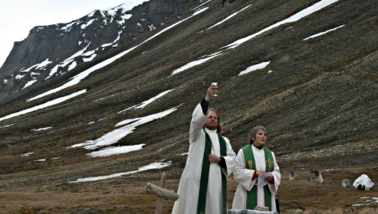 Leif Magne Helgesen (left) celebrating mass at the Longyearbyen 'cathedral'