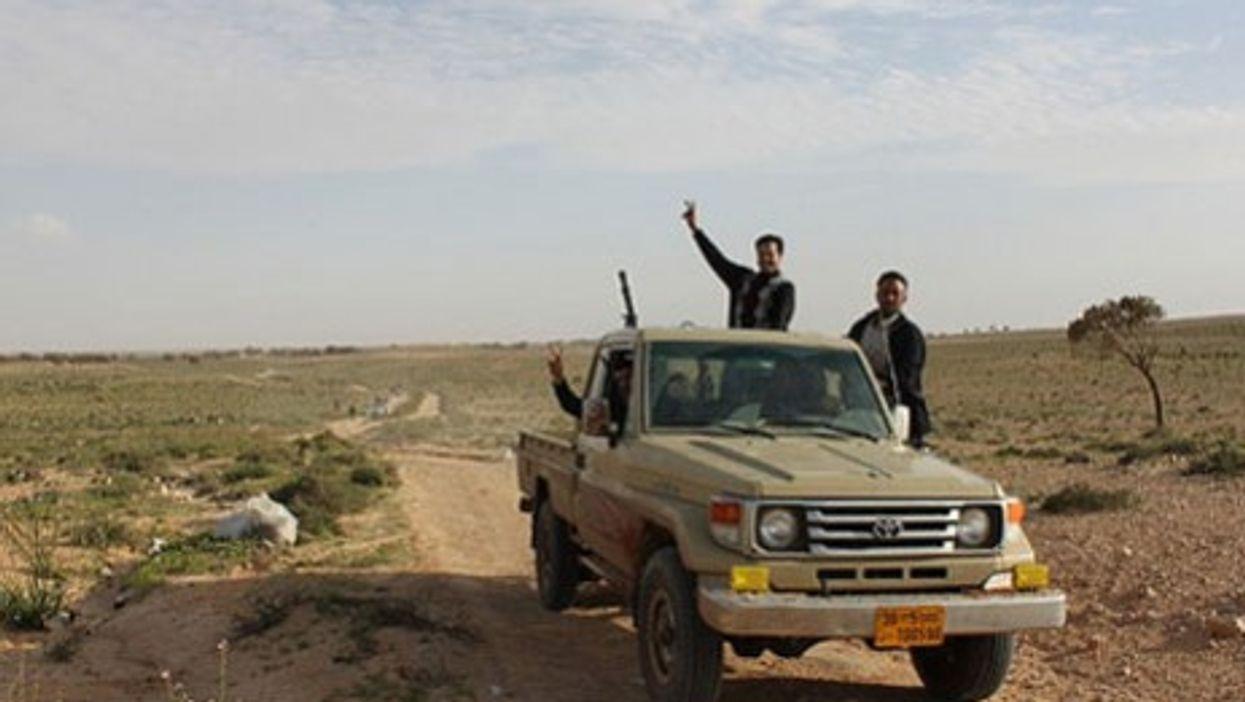 Libyan rebels near Sirte
