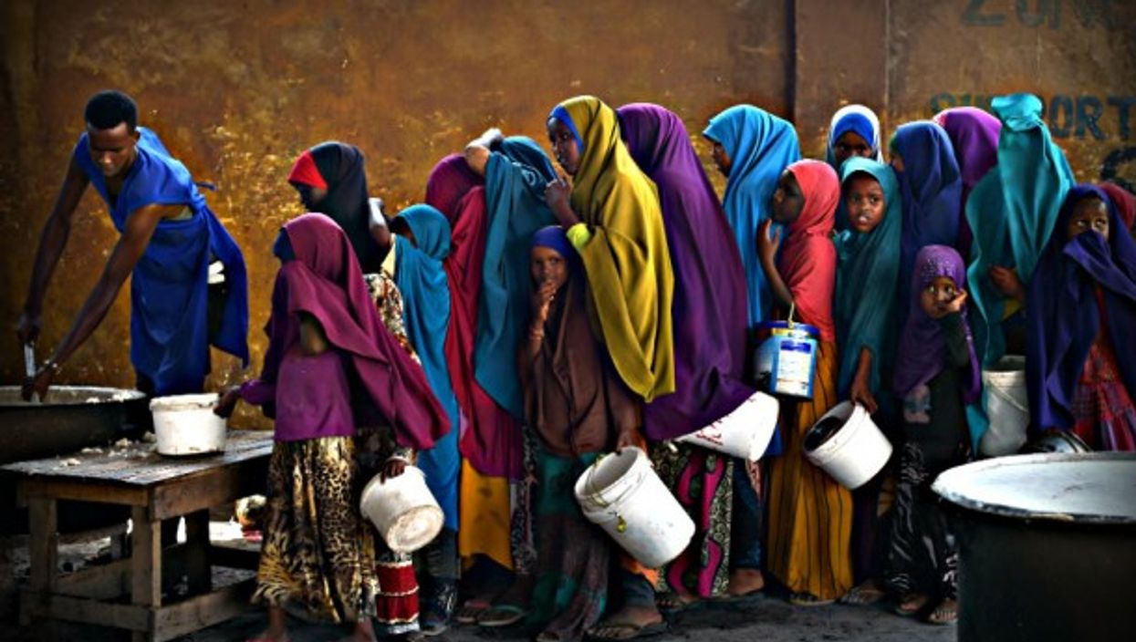 Lining up for food in Somalia, where they are experiencing a severe drought .