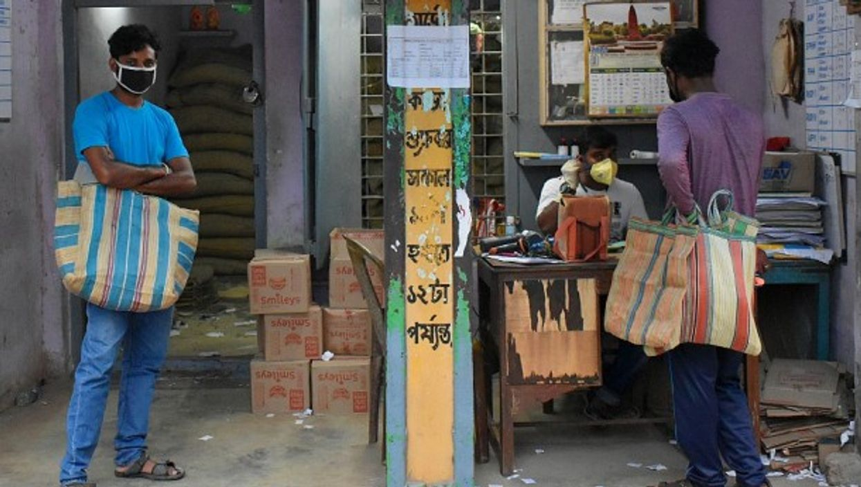 Lining up for rice rations in Kolkata.