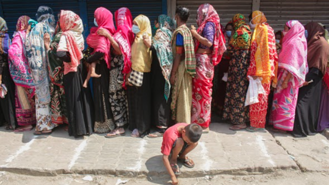 Lining up to buy rice and flour in Sylhet, Bangladesh as the country starts a 7-day lockdown.