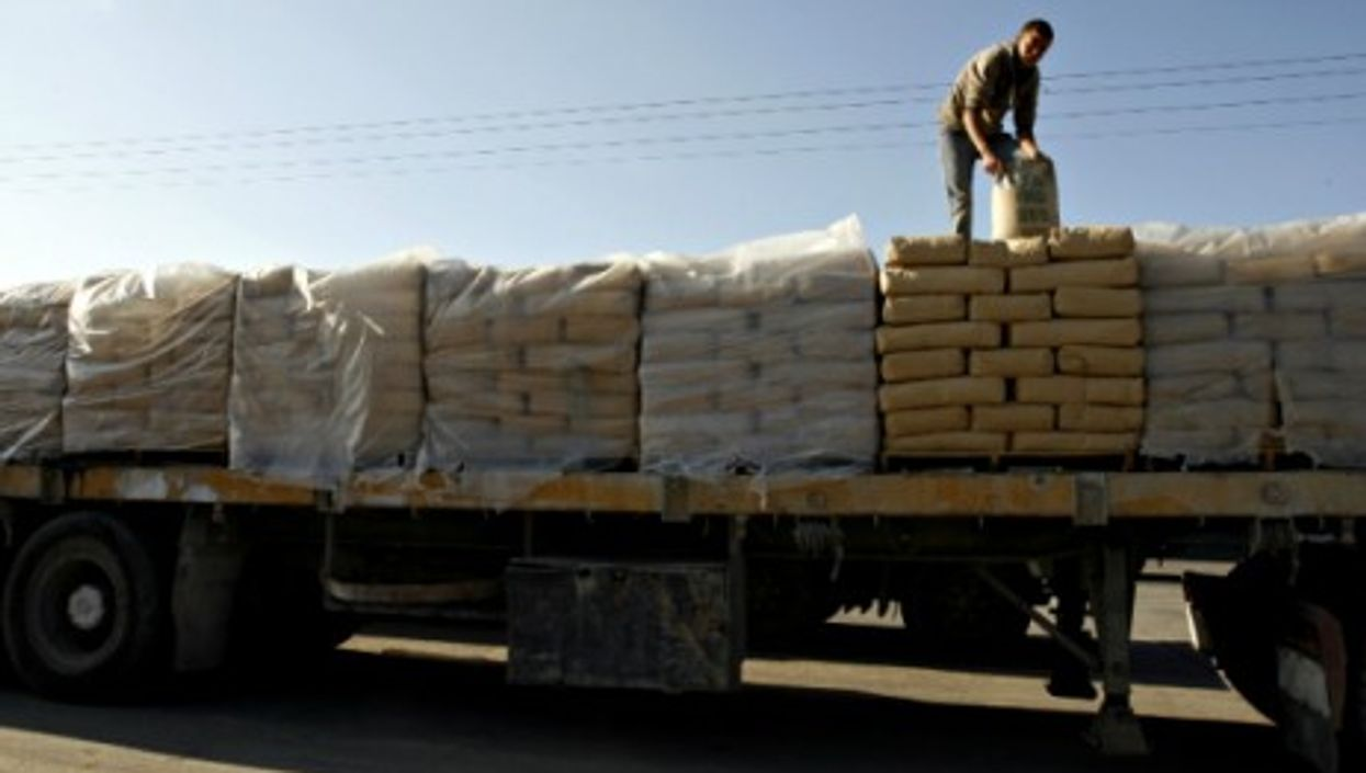 Loading cement on a truck in Rafah