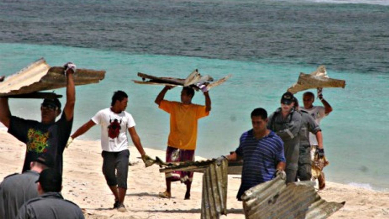 Local volunteers cleaning up debris in Samoa.