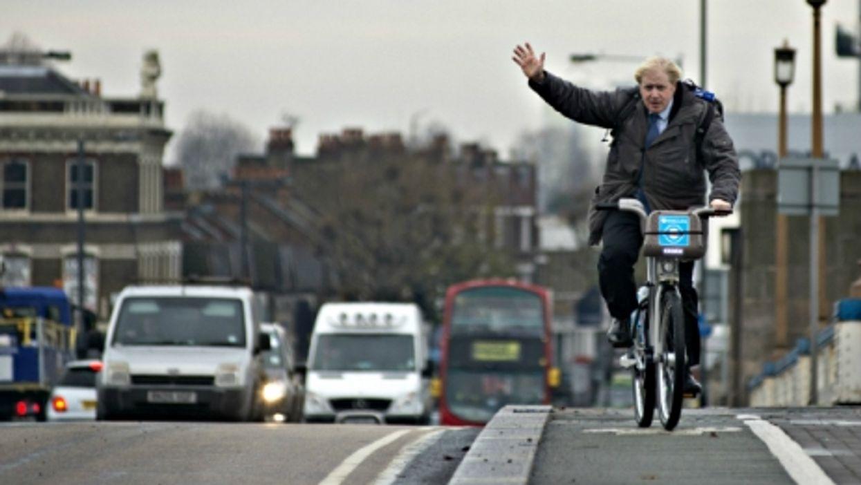 London Mayor Boris Johnson cycling in the city