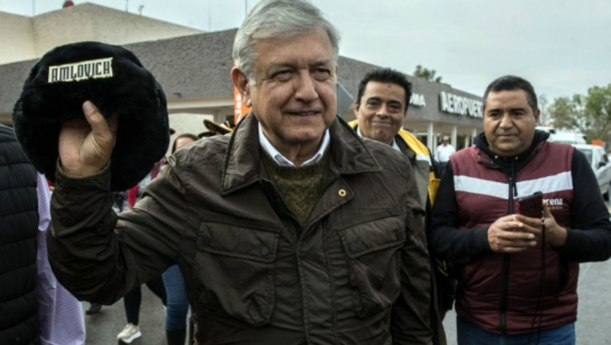 López Obrador holding a traditional Russian hat