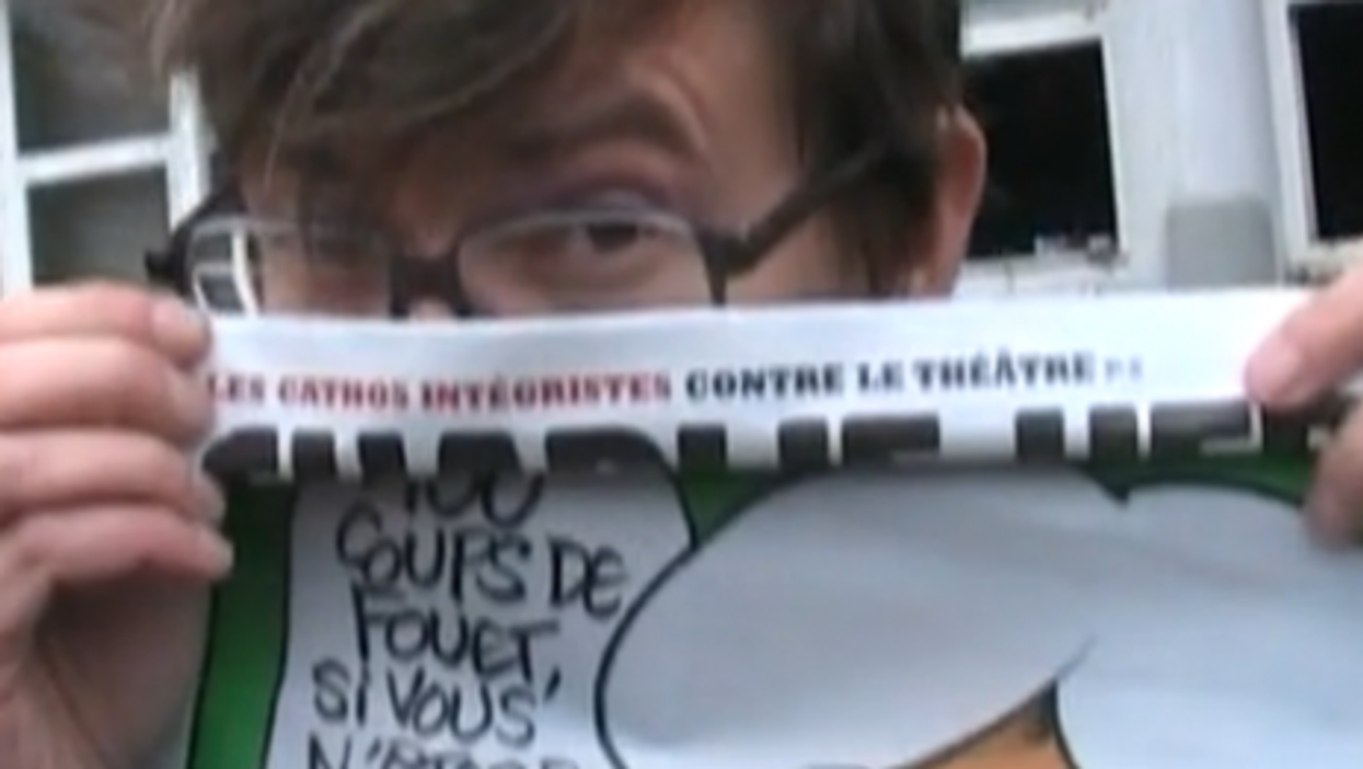 Luz, a Charlie Hebdo cartoonist, with Mohammed cover, outside magazine's firebombed offices (Rue89)