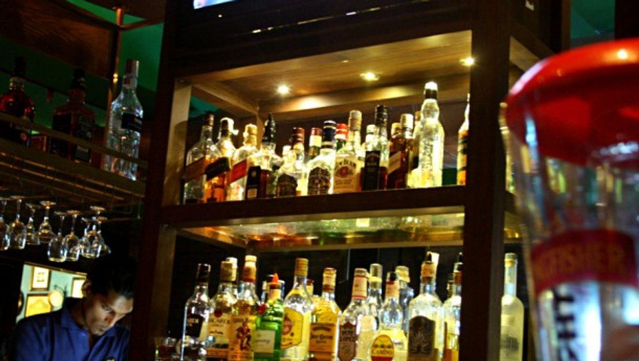 Man bartending at a famous pub in South Mumbai