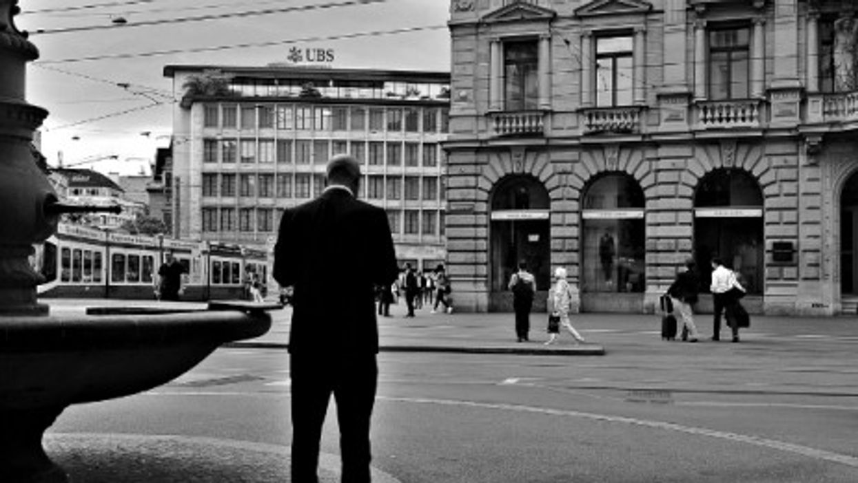 Man in front of a UBS bank in Zurich