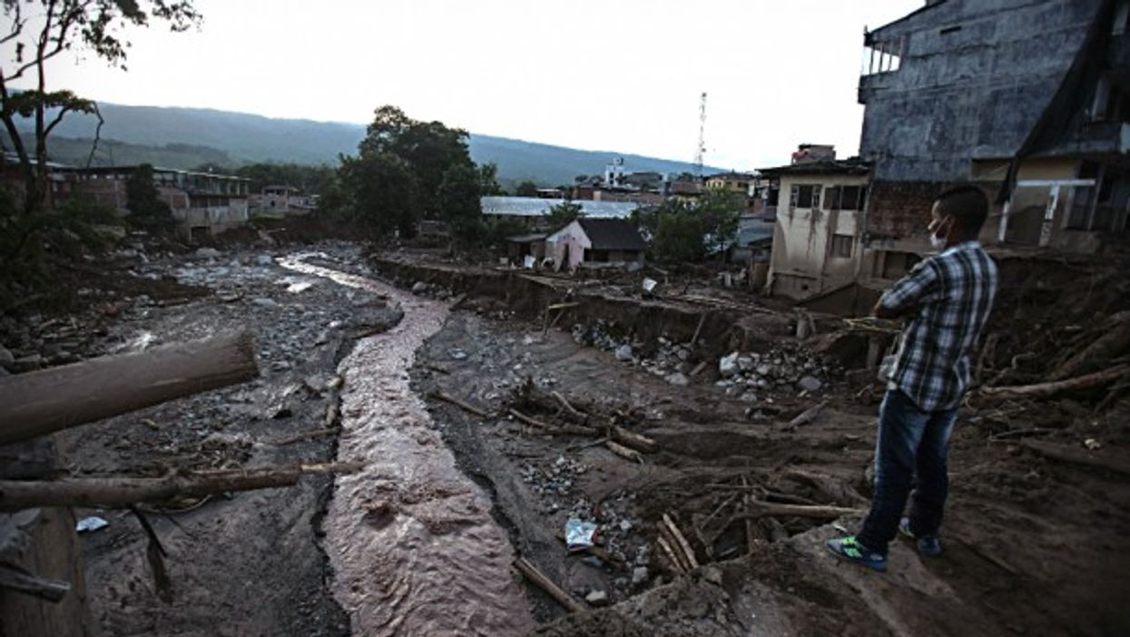Man looking at the debris in Mocoa on April 5