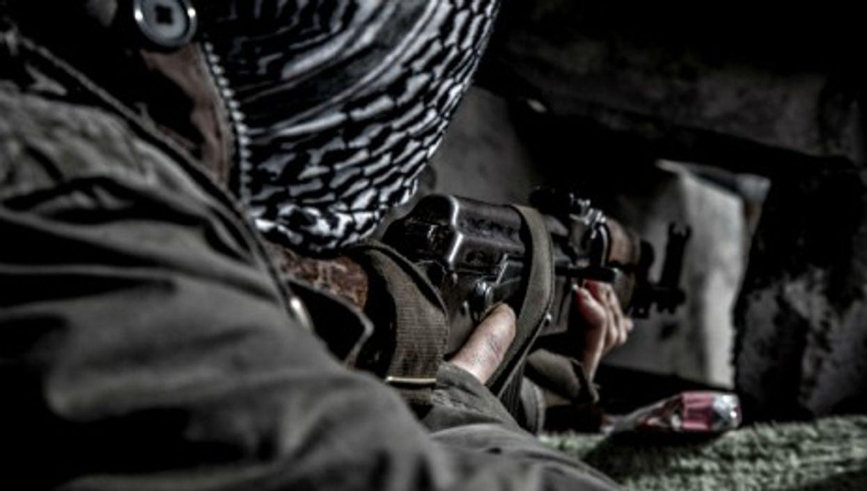 Man practicing shooting in Kobane, Syria