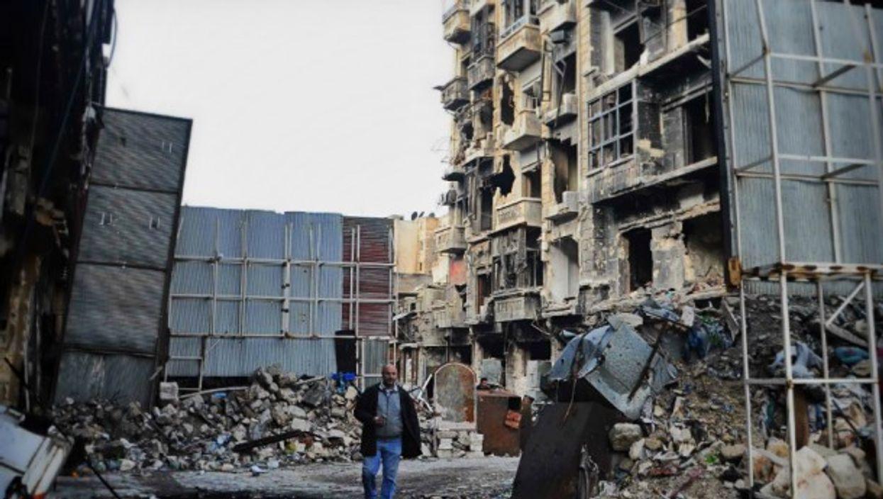 Man walking in Aleppo on Dec. 17