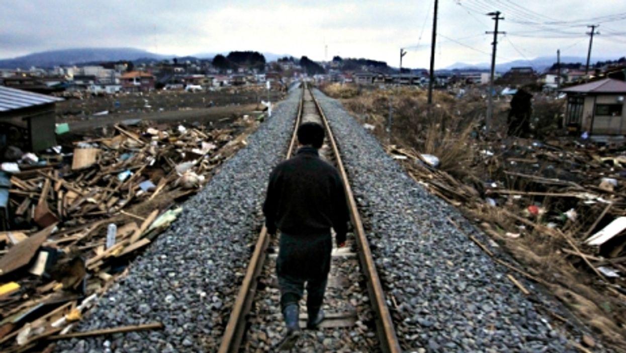 Man walking in Kesennuma, Tohoku, after the March 2011 earthquake